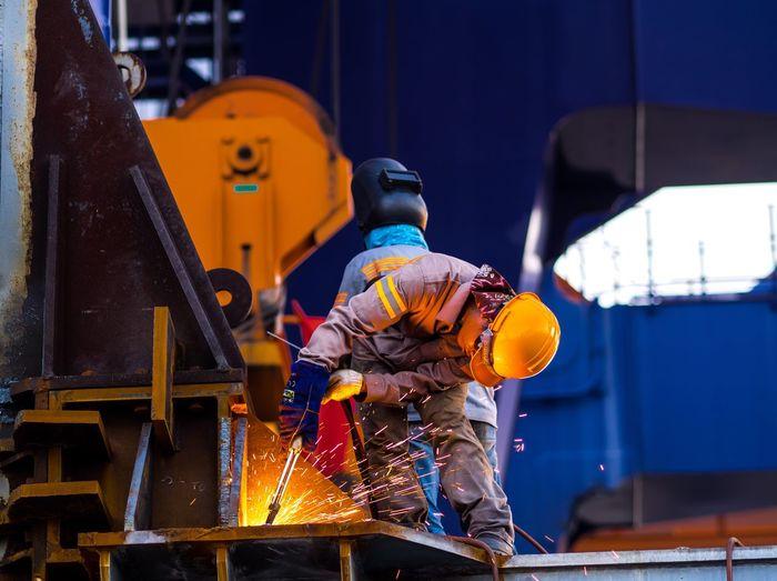 construction Constructed Repairs Heavy Equipment Bridge Port Building - Activity Cutting Weld Welding Helmet Welder Man Fire Safety