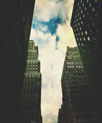 Architecture Building Building Exterior Built Structure City Clouds And Sky Day Development History Low Angle View Modern New York City No People Office Building Outdoors Shadows Skyscraper Tall Tall - High Tower