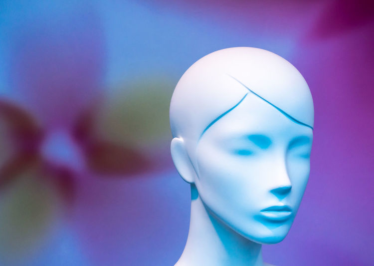 Close-up of mannequin against colored background