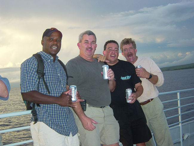 Jan 2004 - Lahaina Rhoads, Hawaii Hawaiian Style Lahaina Rhoads Late Afternoon Adult Alcohol Cloud - Sky Drink Drinking Food And Drink Group Of People Happiness Looking At Camera Males  Mature Adult Mature Men Men Mid Adult Men Outdoors Portrait Refreshment Smiling Standing Togetherness