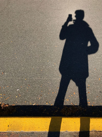 Shadow selfie with yellow line. New Jersey, USA. Photo by Tom Bland. City Life Copy Space Figure Lifestyle Man Paint The Town Yellow Road ShadowSelfie Shadowplay Focus On Shadow IPhone One Person Outdoors People Person Selfie Shadow Street Technology Urban Yellow
