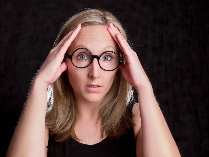 Portrait Looking At Camera Hair Black Background Eyeglasses  Headshot One Person Blond Hair Glasses Front View Young Adult Indoors  Studio Shot Women Young Women Beauty Hairstyle Adult Long Hair Beautiful Woman Head In Hands Teenager Making A Face