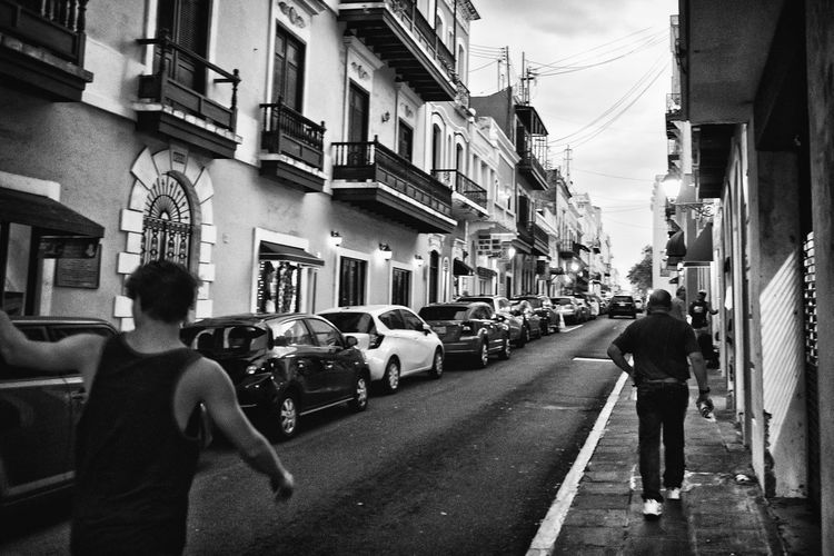 On the streets of Old San Juan, Puerto Rico. Architecture Black & White Blackandwhite Building Building Exterior Built Structure City City Life City Street D7000 Diminishing Perspective Monochrome Nikon D7000 Old San Juan PR Outdoors Puerto Rico Road San Juan PR Street Photography Streetphotography Urbanphotography Vanishing Point The Street Photographer - 2016 EyeEm Awards