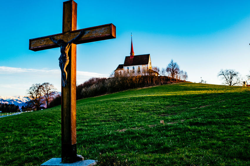 Architecture Blue Building Exterior Built Structure Church Clear Sky Cross Field Gormund Grass Grassy Kapelle Landscape Nature Place Of Worship Religion Rural Scene Sky Spirituality Tree