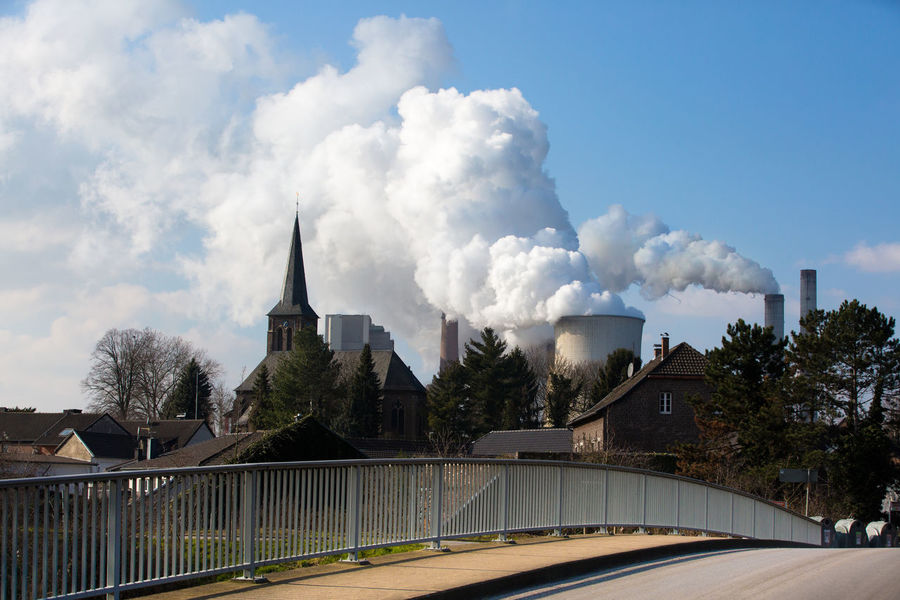 Church Air Pollution Architecture Bridge Building Exterior Built Structure Climate Change Cloud - Sky Coal Power Plant Day Emitting Energy Environment Environmental Issues Factory Industry No People Outdoors Plant Pollution Sky Smoke - Physical Structure Smoke Stack Tree Village The Architect - 2018 EyeEm Awards