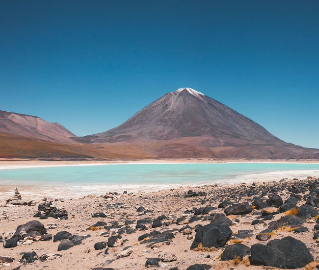 Laguna Verde, Bolivia Clear Sky Desert Travel Adventure Arid Climate Blue Day Environment Idyllic Laguna Verde Landscape Mountain Mountain Peak Mountain Range No People Non-urban Scene Rocks Salt Flat Scenics - Nature Snowcapped Mountain Tranquil Scene Travel Destinations Turquoise Volcano Water