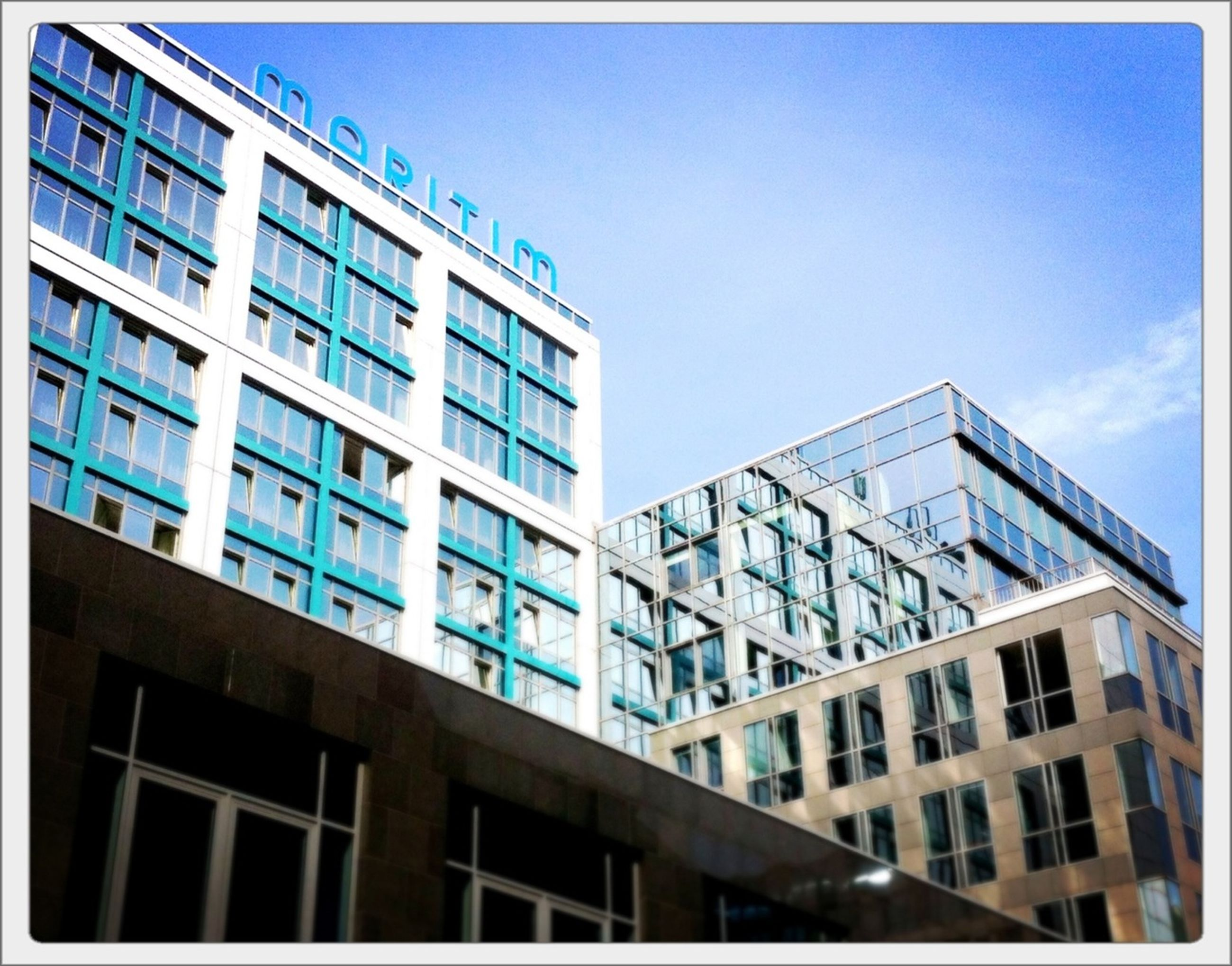 architecture, building exterior, built structure, low angle view, window, city, building, modern, blue, sky, office building, glass - material, residential building, clear sky, residential structure, day, transfer print, auto post production filter, apartment, reflection