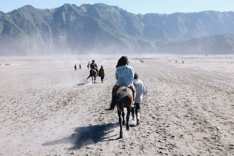 Riding long way in Bromo Valcano area People And Places Bromo Mountain Indonesia Riding Horse Nature Mountain Scenics Beauty In Nature Sand Sky