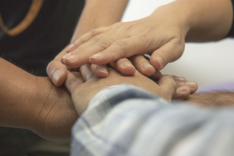 Close-up of friends stacking hands