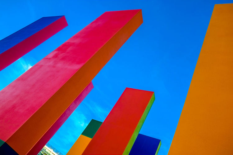 Architecture and urban design with blue sky in the background Architecture Art And Craft Backgrounds Blue Built Structure Clear Sky Close-up Day Full Frame Low Angle View Metal Multi Colored Nature No People Outdoors Pattern Red Sky Striped Vibrant Color