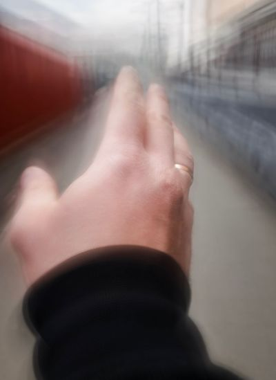 Real People Human Body Part One Person Hand Human Hand Body Part Blurred Motion Personal Perspective Motion Transportation Men Indoors  Finger Focus On Foreground Day Window Lifestyles Mode Of Transportation Glass - Material Close-up