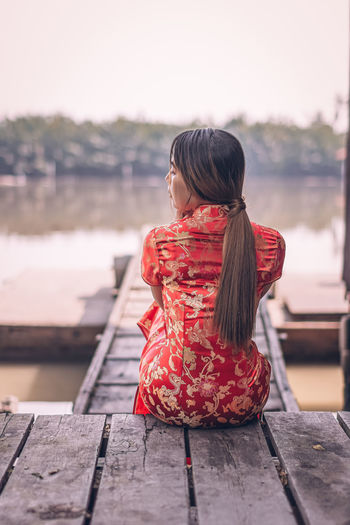 Young woman in traditional clothing outdoors