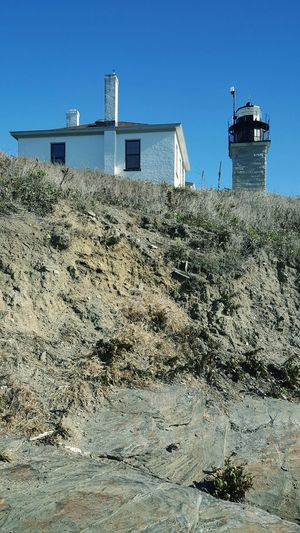 Beavertail Lighthouse. Blue Sky Sky Sunlight By The Sea Cliff Building Exterior Lighthouse View Lighthouse_captures Lighthouse_lovers Beacon Coastal Views Scenics Rock - Object EyeEm Best Shots EyeEm S6 Jamestown, RI Rhode Island Photography⚓