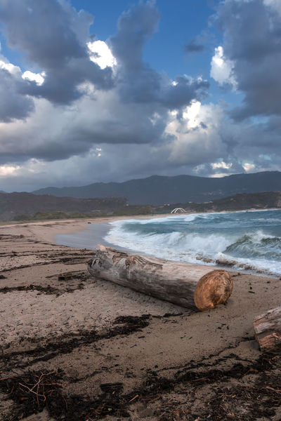 view over beach from sagone Holiday Stormy Sea Beach Beauty In Nature Bridge Cloud - Sky Corsica Day Nature No People Outdoors Sagone Sand & Sea Scenics Sea Sky Storm Cloud Tranquil Scene Tranquility Water Waves, Ocean, Nature A New Beginning