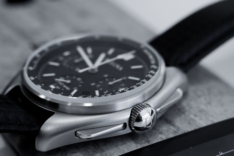 High angle view of wristwatch on table