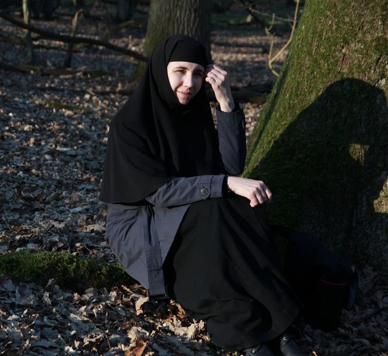 Portrait of orthodox nun in forest