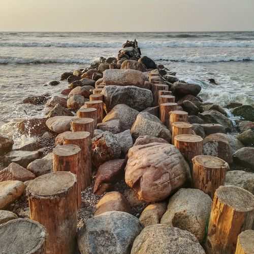 Rocks and wooden posts at beach