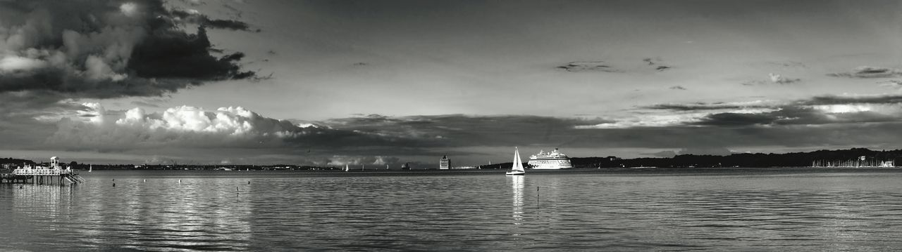 3 photos in one row = panoramic view ;)Dramatic Sky Dramatic Black And White Awesome_view S/w-Fotografie Reflections And ShadowsKiel The Essence Of Summer Photography In Motion Feel The Journey Cruise Ship Stormy CloudsCoastline Baltic Sea The Great Outdoors - 2016 EyeEm Awards Sailing Kieler Woche Landscapes With WhiteWall Panoramic Landscape Panoramashot Panoramic Photography Landscapes The Great Outdoors With Adobe Panorama Storm Clouds Panorama View Adapted To The City Lost In The Landscape