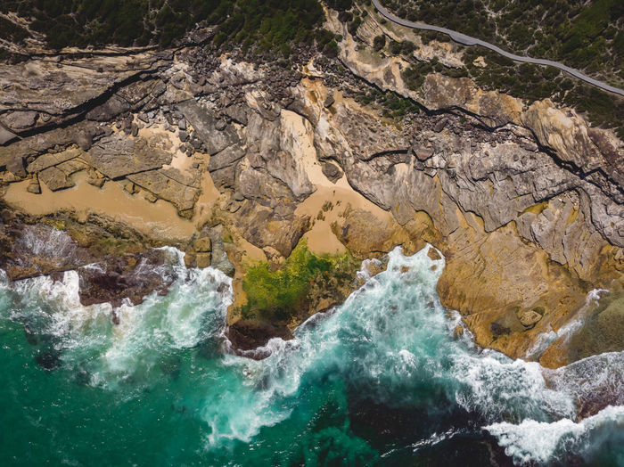 Aerial drone shot of rocky coastline and ocean waves along Australia's coast, Royal National Park, Sydney. Beauty In Nature Water Sea Rock Nature Outdoors High Angle View Day Power In Nature Royal National Park Sydney Australia Coastline Hiking Adventures Drone  Drone Photography DJI Mavic Air Birds Eye View Waves Rock Formation Trail Sunlight Power Flowing Water Breaking