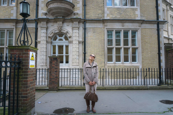Adult Adults Only Architecture Beige Tones Building Exterior Built Structure City Day Full Length London City Life London Lifestyle Looking Up One Person Outdoors Standing Street Streetphotography Woman