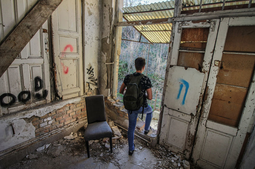 The Secret Spaces Destroyed House Destroyed Building Empty House Empty Room House Wide-angle Photography Graffiti Abandoned House Abandoned Buildings Abandoned EyeEmNewHere People Physical Activity Men Walking Only Men One Person Architecture