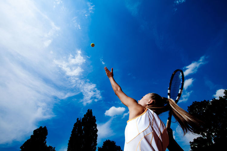 Tennis Player Playing Against Sky