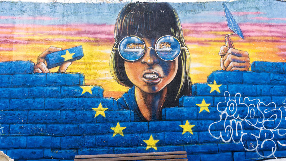 mural in Lisbon, Portugal Blue Boat People Brick Brick Wall Creativity Criticism Dinghy Europe Fortress Europe Front View Graffiti Migration Mural Refugees Street Art