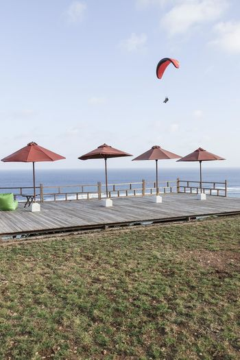 Paragliding Beach Beauty In Nature Day Horizon Horizon Over Water Land Nature No People Non-urban Scene Outdoors Parasol Park Scenics - Nature Sea Shade Sky Tranquil Scene Tranquility Umbrella Water