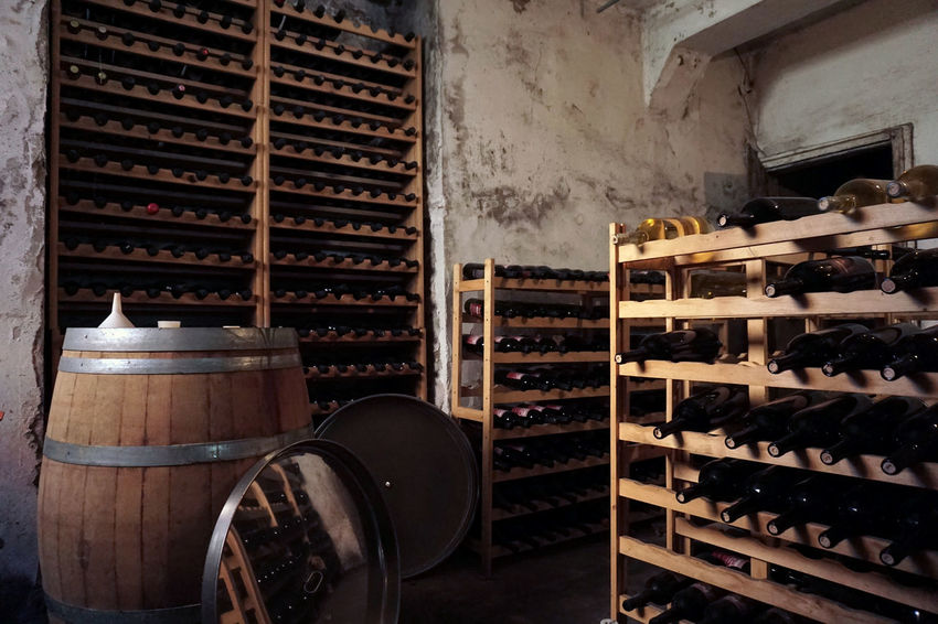 Interior Of Winery Abruzzo Alcohol Barrel Cellar Day Drink Food And Drink Indoors  Interior Of Winery Large Group Of Objects No People Perano Shelf Stack Storage Compartment Storage Room Wine Wine Bottle Wine Cellar Wine Rack Winemaking Winery Wood - Material