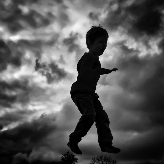 Backlight Blackandwhite Boys Childhood Cloud - Sky Day Full Length IPhoneography Jumping Nature One Boy Only One Person Outdoors People Real People ShotOniPhone6 Silhouette Sky Skyporn