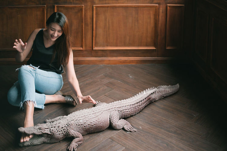 Crocodile eating human leg. Reptile One Person Women Wood - Material Indoors  Adult One Animal Vertebrate Wood Beautiful Woman Hairstyle Crocodile Dreaming Fake Stuffed Crocodile Stuffed Stuffed Animals Fake Crocodile Scared Face Bfriends Blackmail Footless Bird Leaf Bite Disabled