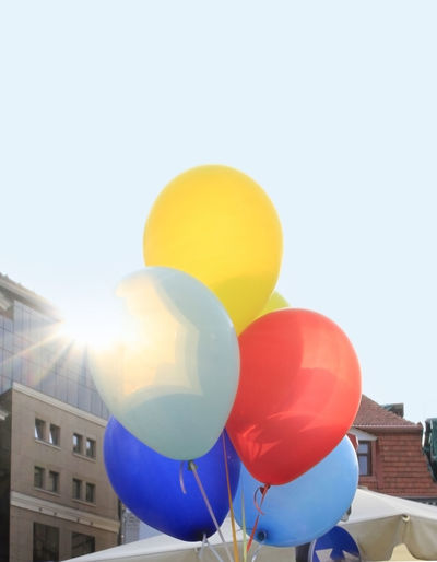 Low angle view of balloons against clear sky