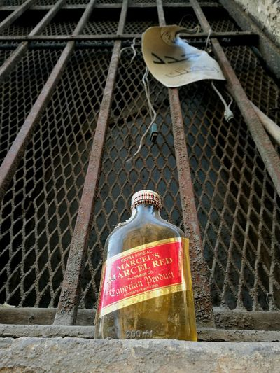 Outdoors Low Angle View No People Day Close-up Whiskey Alcohol Left Behind Windowsill Downtown Cairo Egypt Contrasts Pattern Building Exterior Color Contrasts Cheers Bottle Cable