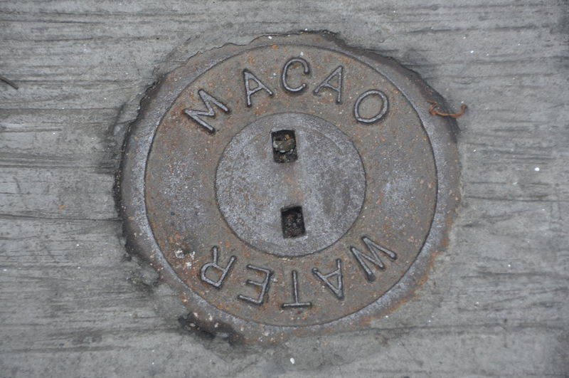 High angle view of text on manhole