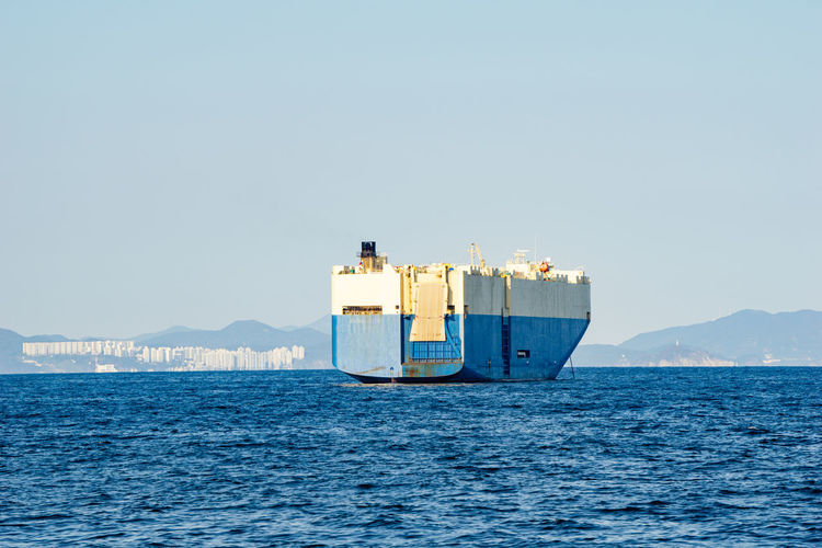 Nautical vessel on sea against clear sky