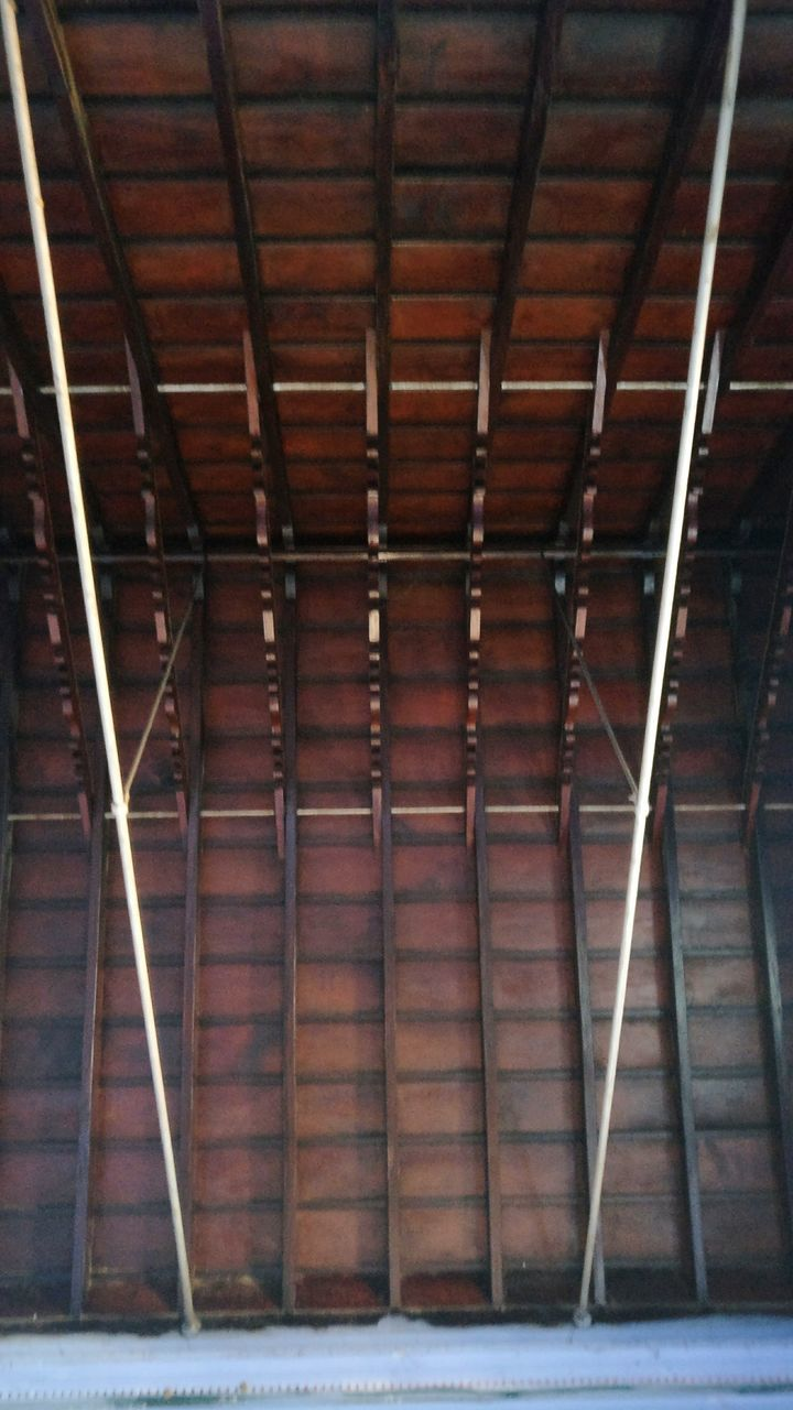 architecture, indoors, no people, built structure, ceiling, metal, pattern, day, building, low angle view, illuminated, wall, roof, lighting equipment, absence, brick wall, wood - material, brown, empty, architectural column, roof beam