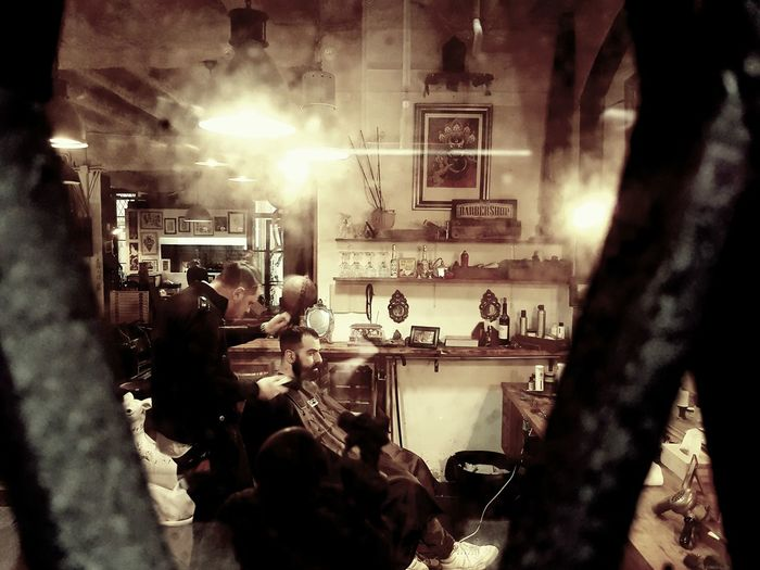 Explore Barcelona Only Men Real People Adults Only Men People Indoors  Technology Adult Day Explore Barcelona Barcelona Street Walking Window Barbershop Barber Shop By The Window Jobtime The City Light EyeEmNewHere