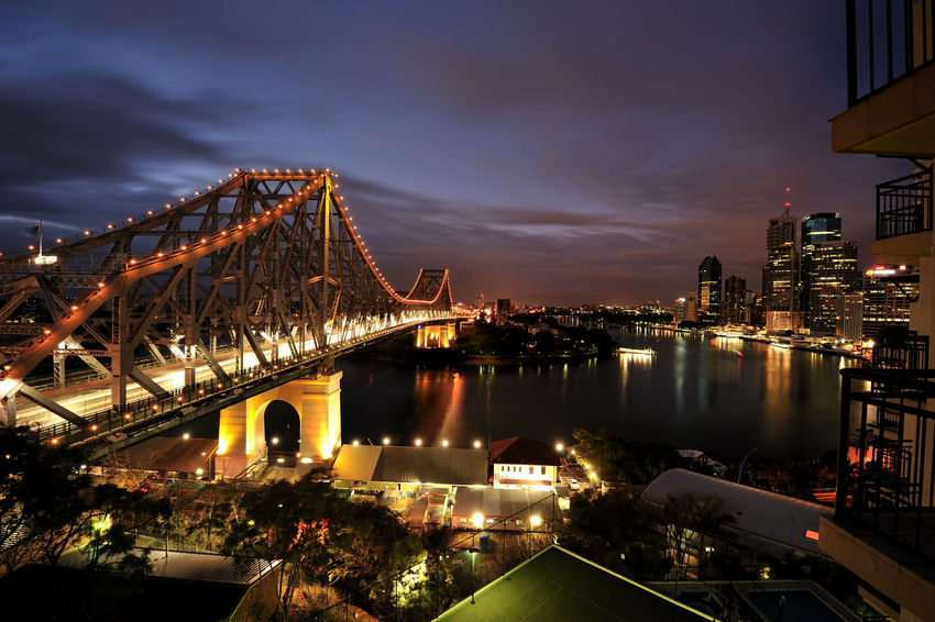 Brisbane Bridge. Brisbane Brisbane Bridge Architecture Bridge - Man Made Structure Building Exterior Built Structure City Cityscape Cloud - Sky Connection Illuminated Nature Night No People Outdoors River Sky Transportation Travel Destinations Tree Water