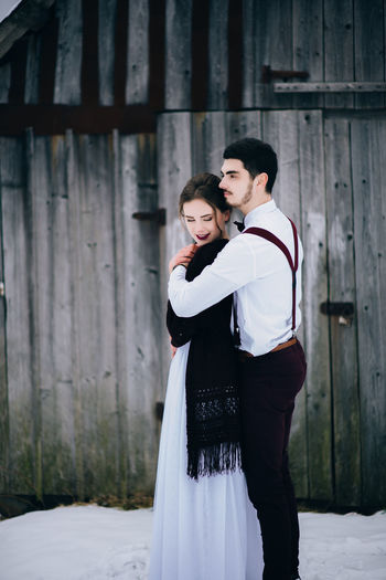 Full length of couple standing outdoors