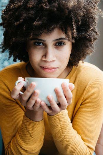 Portrait Of Teenage Girl Having Coffee In Cafe