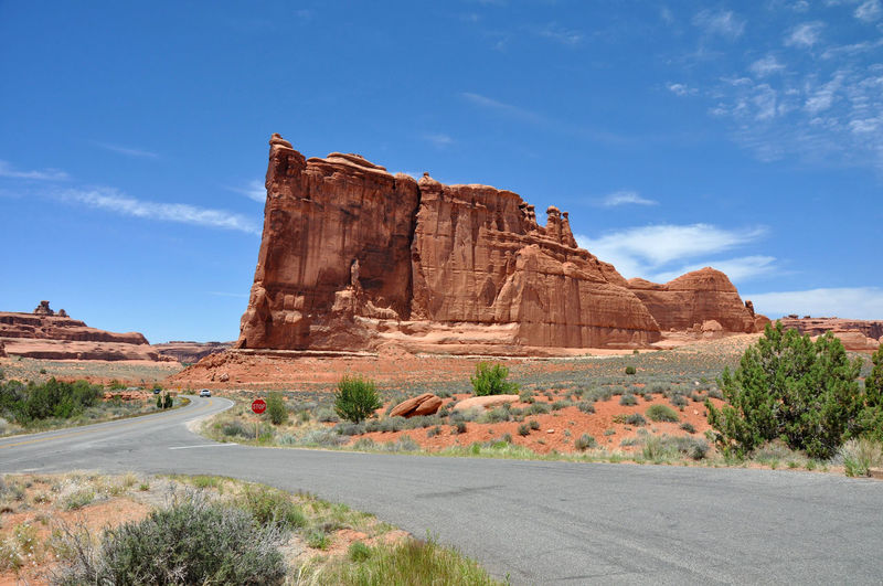 Road and rocky mountains at arches national park