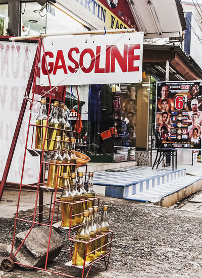 Petrol/gasoline for sale in bottles at Phuket, Thailand Bottle Bottles Building Exterior Built Structure Day Fuel And Power Generation Gasoline Sign No People Outdoors Perol Foe Sale Retail  Store Text