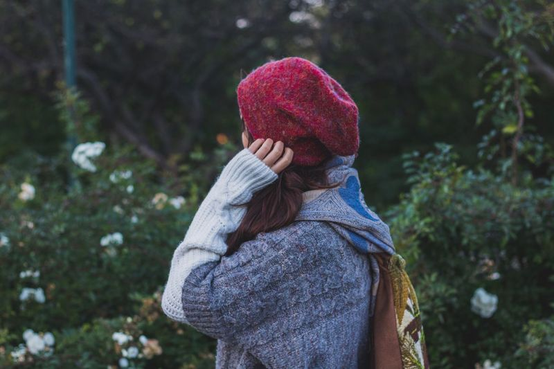 Side view of young woman knit hat