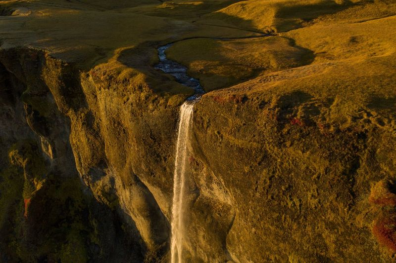 Tall waterfall flowing down mountain 2 Water No People Scenics - Nature Nature Beauty In Nature Non-urban Scene Landscape High Angle View Aerial View Mountain Outdoors Flowing Water Long Waterfall Flowing Waterfall Iceland Waterfall Icelandic Icelandic Nature