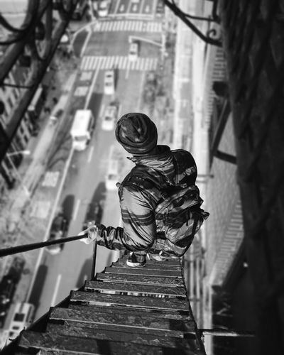 High Angle View Of Man On Fire Escape