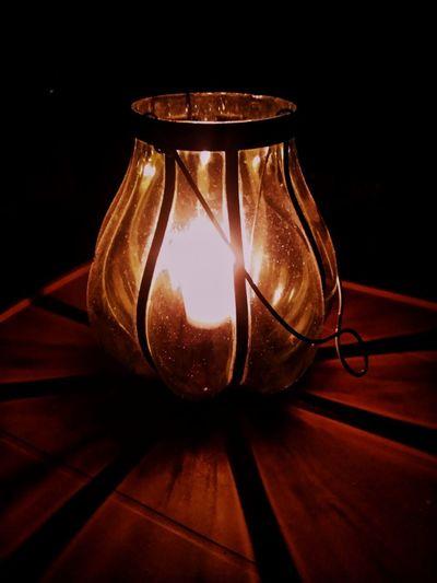 Close-up of illuminated light bulb on table