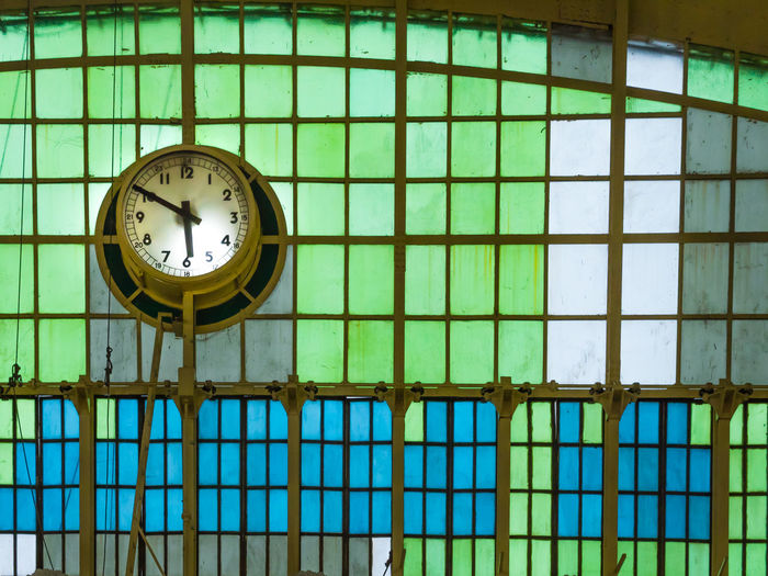 Old clock hang on glass wall in aged hall of railway station. The retro architecture at Bangkok railway station. Ceiling Curve Roof Station Accuracy Architecture Built Structure Clock Close-up Dome Geometric Shape Glass - Material Green Color Indoors  Instrument Of Measurement Low Angle View Metal No People Number Pattern Shape Terminal Time Wall - Building Feature Window