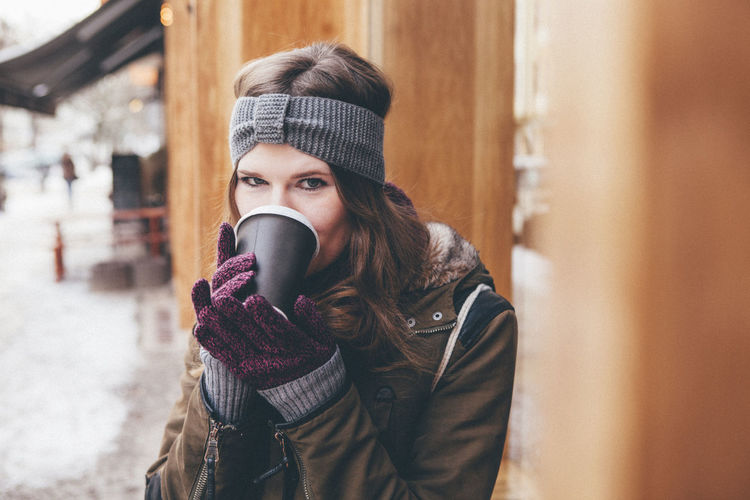 Coffee Cold Door Freezing Gloves Green Livestyle Long Hair Smile Snow To Go Urban Winter Young Adult Young Women #HolidayMarketing