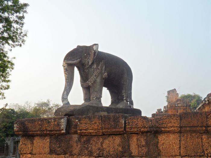 Elephant statue at Angkor Sculpture Art And Craft Statue Sky Representation Architecture Clear Sky Elephant Low Angle View Old No People Animal Themes