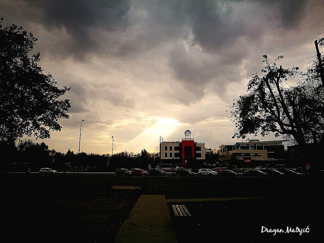 sky, cloud - sky, tree, built structure, building exterior, architecture, car, city, sunset, no people, storm cloud, outdoors, nature, day, cityscape
